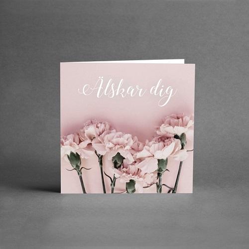 Gratulationskort med rosa nejlikor och text älskar dig från card store