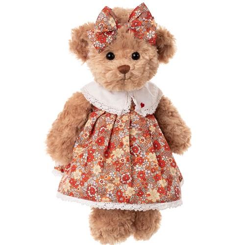 Nallen Helena med vacker blommig klänning och finaste rosetten i håret. En nalle i storlek 35cm.