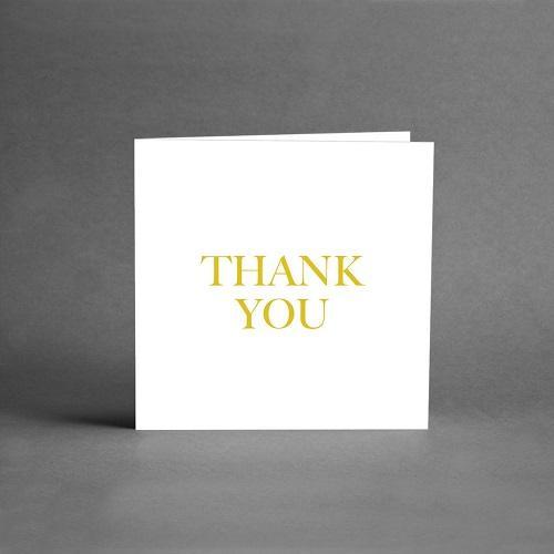 Gratulationskort med vit botten och text i guld Thank you från Card Store