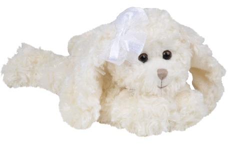 En mellanstor hund i vit härlig syntetpäls från Bukowski Design med rosett i ena örat